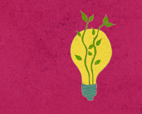 Sustainable Ideas - light bulb with nature growing around it